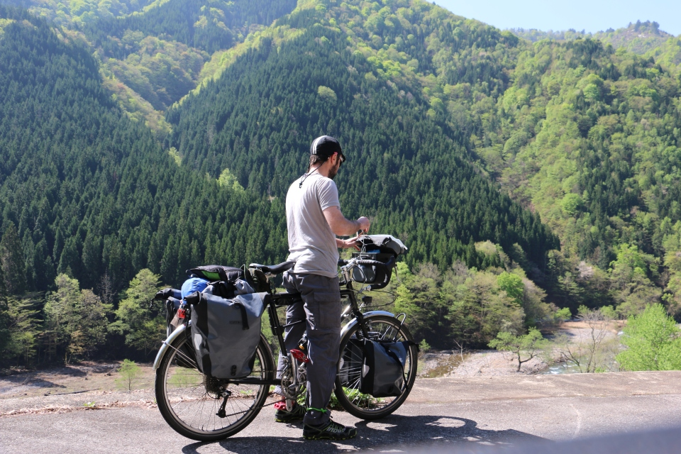 cycle touring in the Japanese Alps. Checking the map.