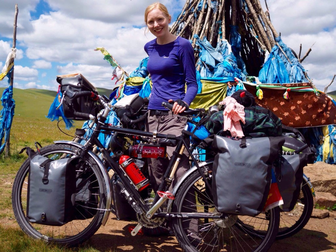 Laura in front of a Mongolian Buddhist shrine with Surly bicycles and Ortlieb panniers. Cycle tour of Mongolia | Crank and Cog.