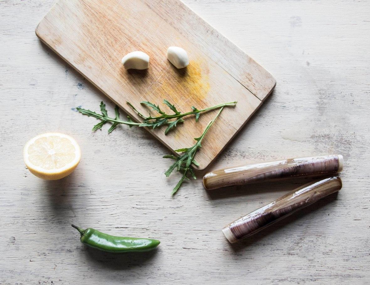 Razor clam recipe. Foraged razor clams, garlic, lemon, butter, olive oil, chilli, rocket leaves, basil, pepper. | Crank and Cog.