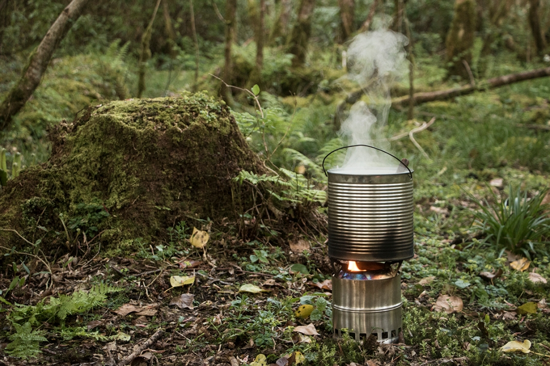 Nettle gruel cooked on a wood stove in the woods | Wild cooking with Crank and Cog.