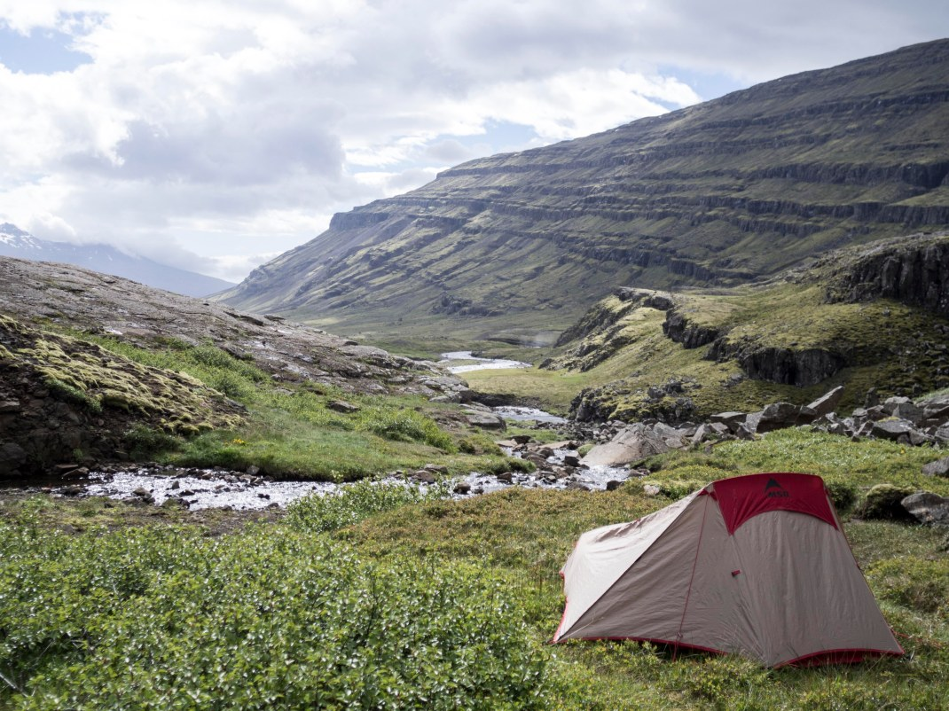 Camping by a stream in Iceland.