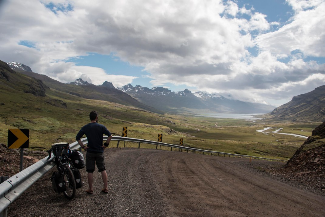 Ciaran admiring the Icelandic countryside on top of the Oxi Mountains, Iceland | Crank and Cog cycle tour of Iceland.