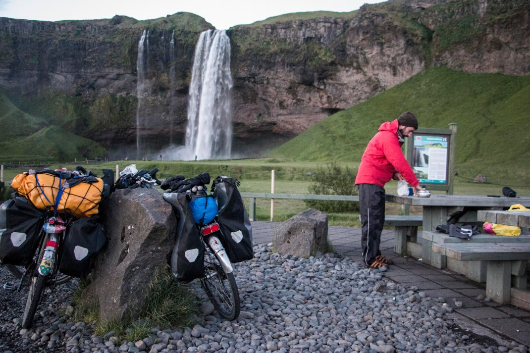 Preparing lunch in front of a waterfall | Crank & Cog cycle tour of Iceland.