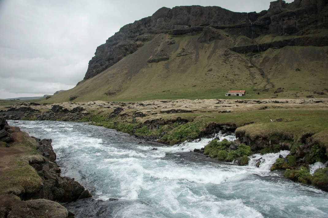 Icelandic stream at the foot of a mountain | Crank & Cog cycle tour of Iceland.
