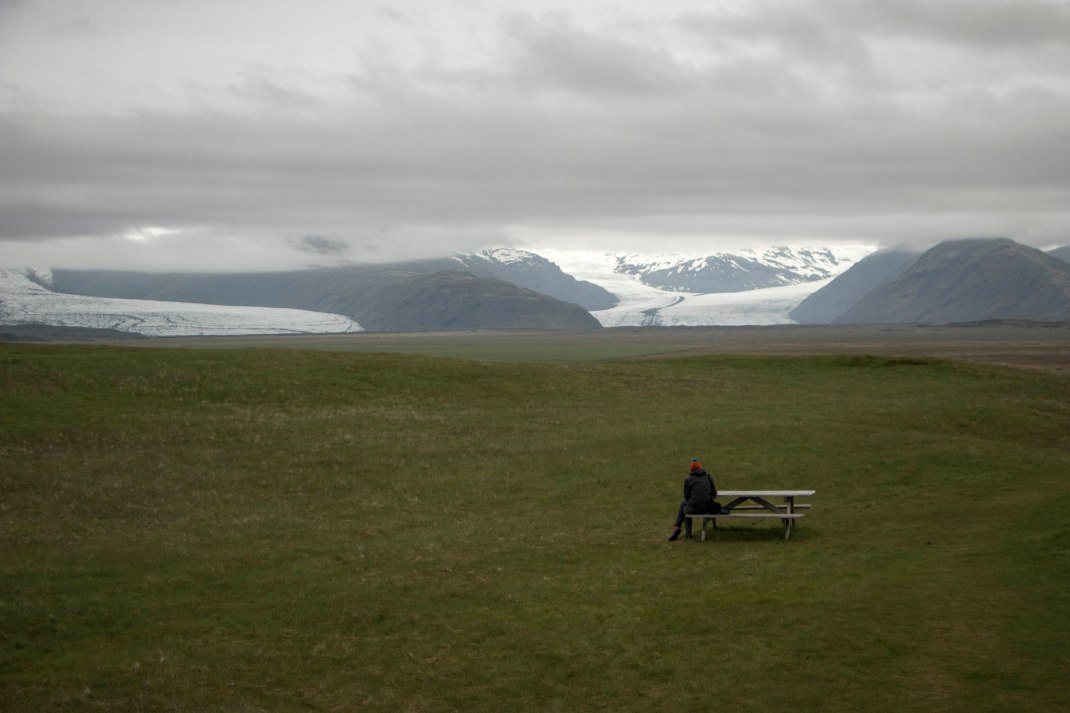 Sitting on a bench in Iceland | Crank & Cog cycle tour of Iceland.